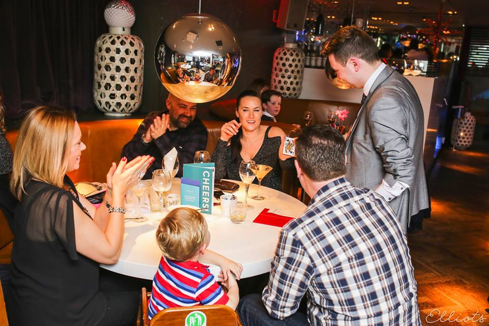 Ayrshire and Glasgow restaurant magician Steven Blair performing for a family